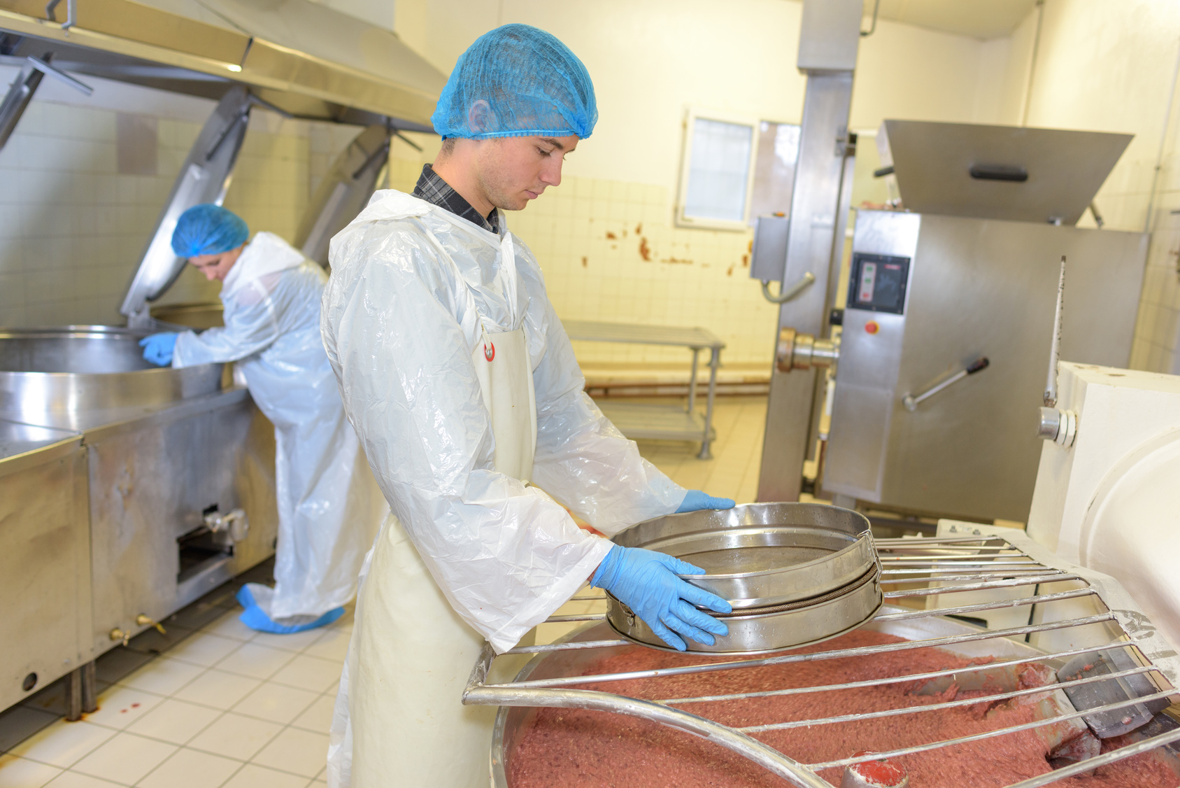 young man working on a food processing factory